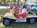 Children ride in Fat Cat's buggy.