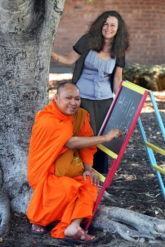 Buddhist monk Narong Kim with his English teacher Michelle Hodges.