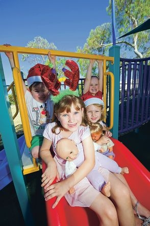 James Morris (3), Sophie Daniel (3), Matilda Brown (6) and Lorelie Brown (4) look forward to the improved playground.