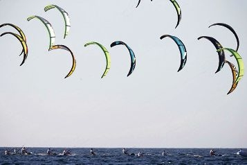 Kitesurfers catching the wind during the competition on Leighton Beach.