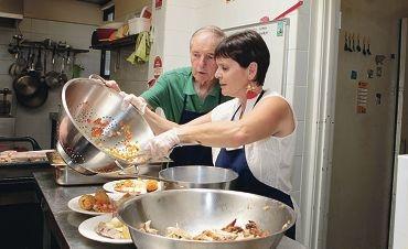 Volunteers Brian Tuana and Ellen Miller.