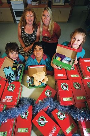 Front: George Daws, Jamie Juncal, Ruby Fox (yr 6's), Back: Shonagh McKenzie (teacher), Angela Bianca (Education assistant) with the Christmas Shoe boxes that Merriwa Primary School has collected to donate