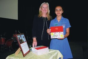 Mayor Tracey Roberts posing with student Harpreet Kaur and her winning Christmas card design.
