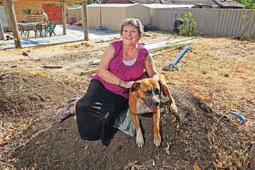Caroline Frigula and Echo are very thankful to volunteers who made over her back yard. Picture: Bruce Hunt www.communitypix.com.au d412520