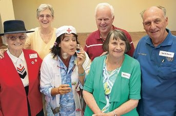 Volunteers Betty Smith-Gander (Red Cross), Isabel Taylor (Ladies Auxiliary), Dr Dippy (hospital clown), Wayne Atkinson (Fremantle Heart Patient Support Group), Gloria Ivey (Nara Volunteers) and Ugo De Marchi (patient transport). Picture: Martin Kennealey d411700