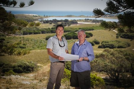 RIA Marine and Terrestrial Services manager Roland Mau and RIA chairman John Driscoll look at the path plans.