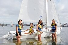 MLC students Iman Welsh (13), Jasmine Rodriguez (10), Coco Ming (12) and Lochie Bruce (12) with a Pacer training dinghy. d411387