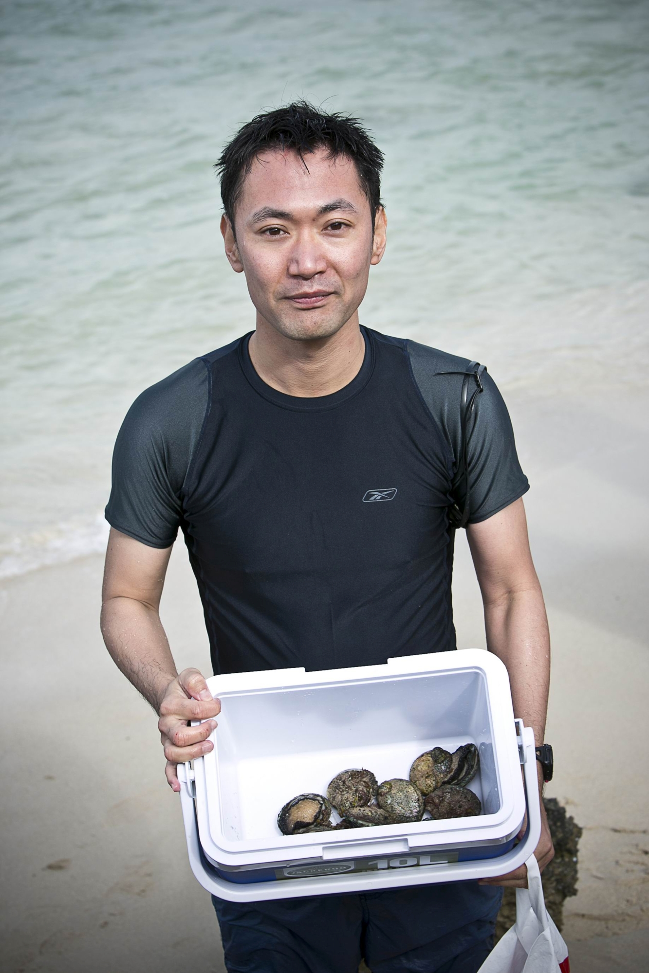 Masa Takahasha with his catch. Picture: Louise White www.communitypix.com.au d412103