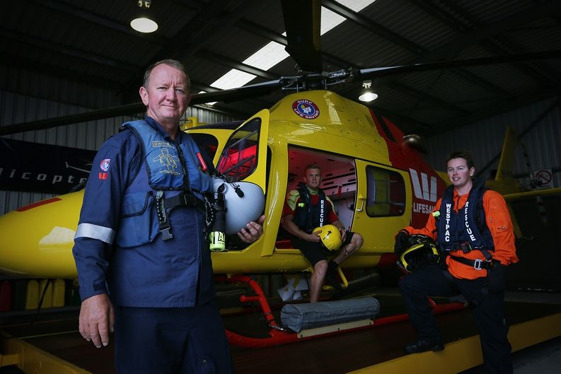 Pilot Andy Jankowski, rescue swimmer Cameron Coulson and air crew Zach Simpson patrol our beaches from the sky. Picture: Andrew Ritchie www.communitypix.com.au d412075