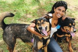 Shenton Park dog refuge volunteer Gaye Path with, from left, Bella, an alaskan malamute) and Rebel, a rottweiler.