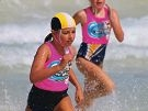 Competitors race across the finishing line. Below: Mullaloo SLSC competitor Chiara Brotzu-Chessa (10).