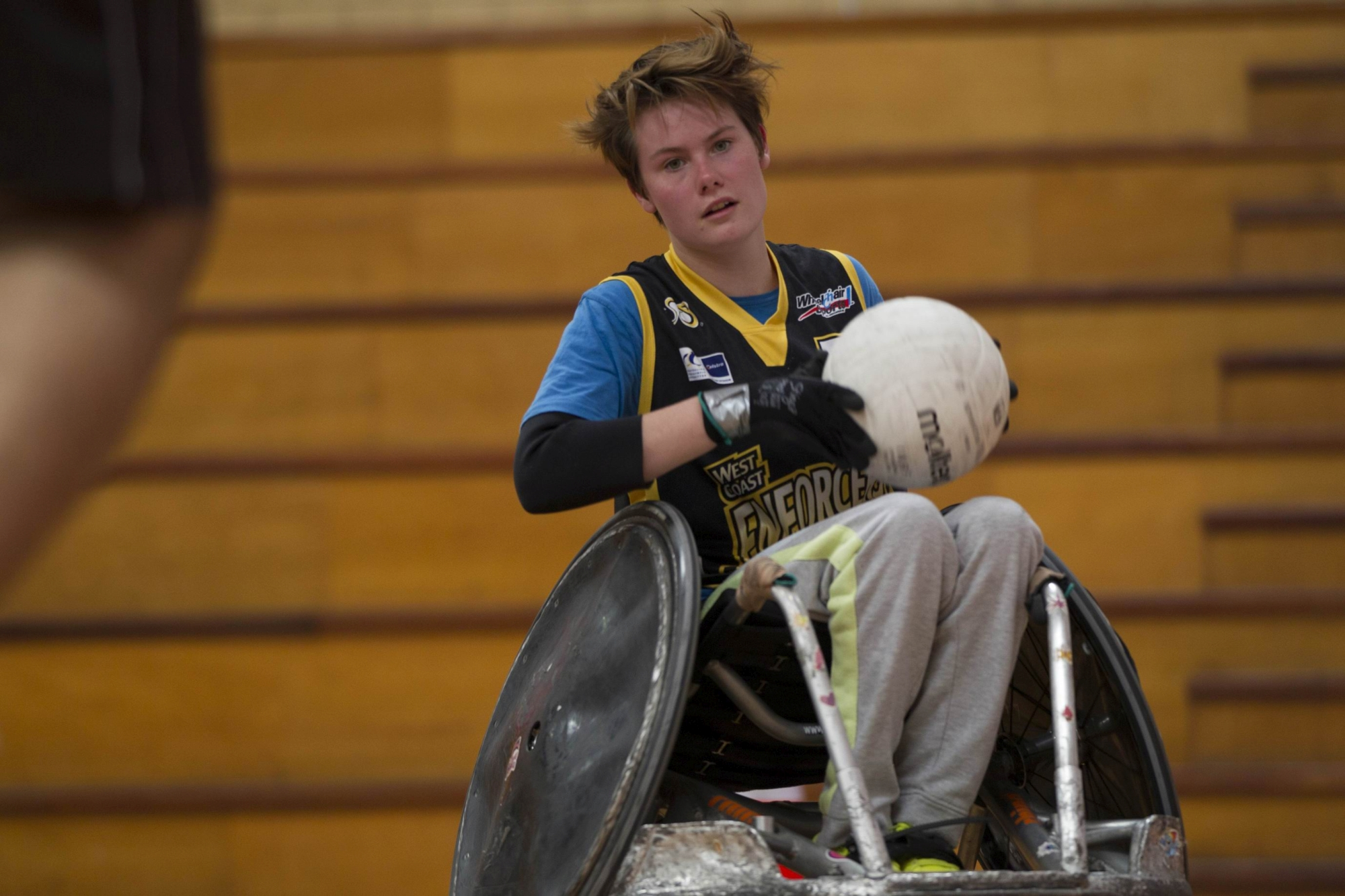 Top: Robyn Lambird-Walton plays for the State wheelchair rugby team West Coast Enforcers. Above: Lambird-Walton in action.