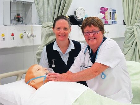 Barb Game with her daughter Rebecca Godin at Challenger Institute's Murdoch campus, where mother and daughter have both qualified as nurses.