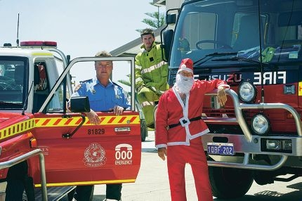 Firefighters Lieutenant Charles Hemsley and Ryan Davies with Simon Gray as Santa from the Yanchep Volunteer Fire and Rescue Service and Two Rocks Volunteer Bush Fire Brigade will be at various parks on Christmas Eve for their annual Santa Run event. Picture: Emma Reeves www.communitypix.com.au d412014