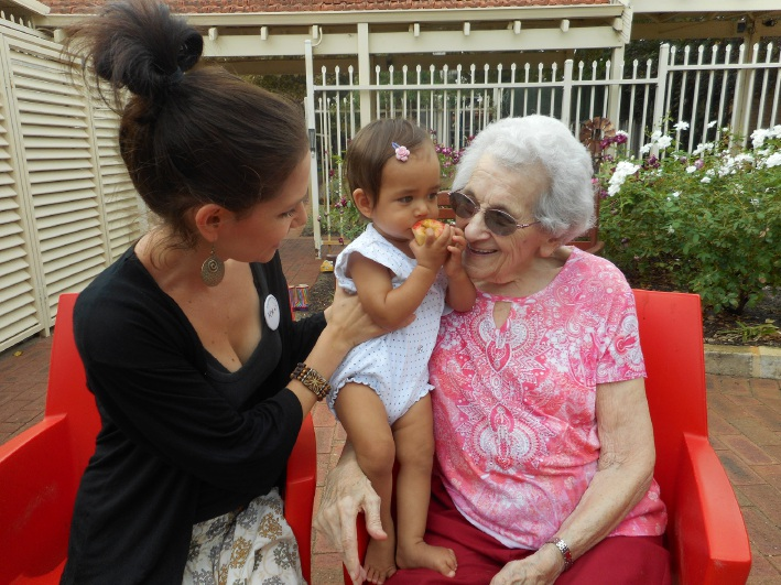 Kylie Chandran and her daughter Syreeta chat with |Brightwater resident Bessie Redman.