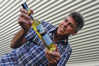Rod Peirce with a bottle of the award-winning olive oil.