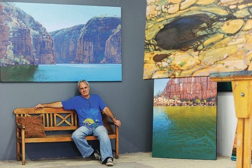 Painter Brendon Darby surrounded by some of his illuminating new work. Picture: Marcus Whisson d411202