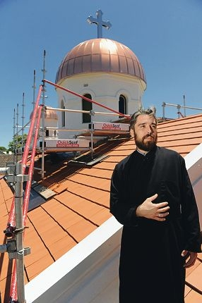 That Reverend Sasa Stojanovic outside the Serbian Orthodox Church of St Sava that is undergoing major restorations.
