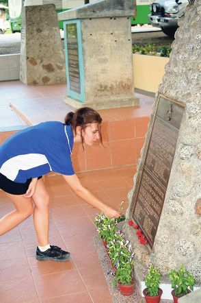 Lia Bannister lays flowers at the Prisoner of War No. 1 Camp at Ranau in Borneo after completing the trek along the death march route.