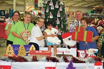 From Left: Sandra Stubbs, Ann Arnold (Wishing Tree champions), Naava Brooks (Salvation Army), Megan Khasuwan (3 yrs), Cymon Brooks (Salvation Army), Branka Pither (Store Manager). Kmart and The Salvation Army launched this years Wishing Tree Appeal
