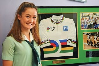 Tian Beckett with the jersey she has donated to her school, Methodist Ladies' College.