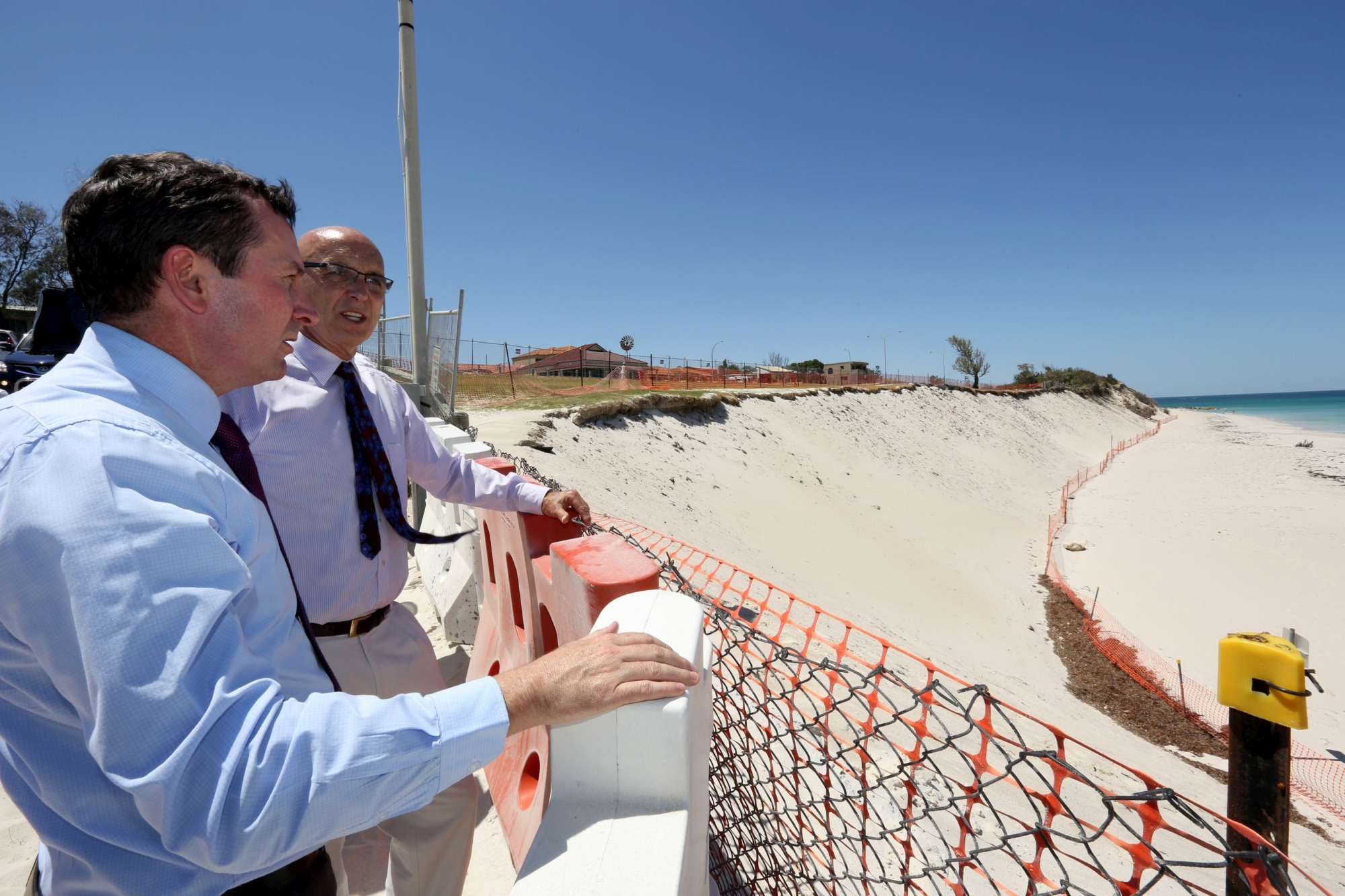 Mark McGowan and John Quigley inspect the erosion site. d411367
