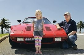 Martin McAllen, of White Gum Valley and his daughter Niamh (4) with his replica Lancia Stratos. Picture: Martin Kennealeyd411140