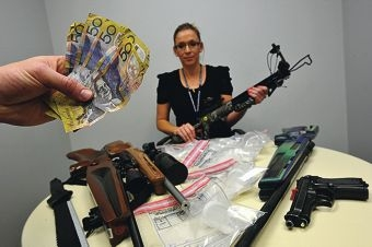 Constable Amber Oldland with some of the siezed items. Picture: Jon Hewson www.communitypix.com.au d411395