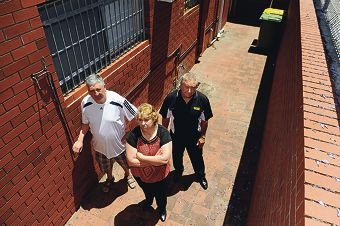 Bayswater newsagent John Davis, Harding and Thornbury Chartered Accountants office administrator Tracy Taylor and Carter's Real Estate's Gary Warne at the back of Harding and Thornbury where people frequently urinate and defecate.