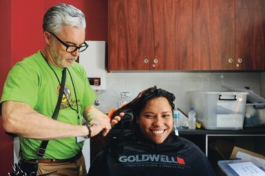 Garrod Keightley from Moeschi Hair Stylists cuts client Teneesha's hair. Picture: Marcus Whisson d411254