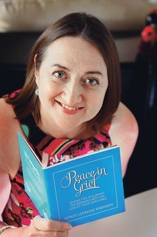 Wendy Robinson with her book Peace in Grief, which she wrote to help people to support the bereaved.