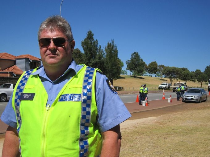 Sgt Peter Shellam with his team testing drivers by the side of Gnangara Road. Picture: Caroline Frank
