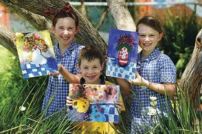 Bassendean Primary School Year 2 students Lucy Coates, Riley Dowd and Cate Anderson with their artwork. Picture: Marcus Whisson d411168