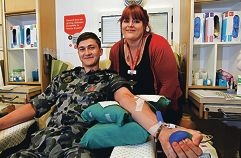 Able Seaman Joshua Tinning donates blood, watched by nursing assistant Naomi Gonsal. Picture: Elle Borgward www.communitypix.com.au d411135