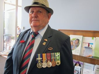 Phillip Warren wears his service medals.