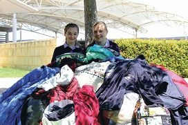 Grace Gornell and Alexandra Robinson with some of the donations.