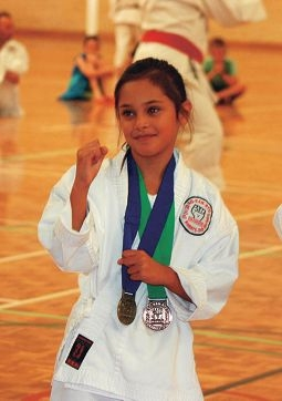 Young club member Maia Jovan has medals to show her skill in karate.