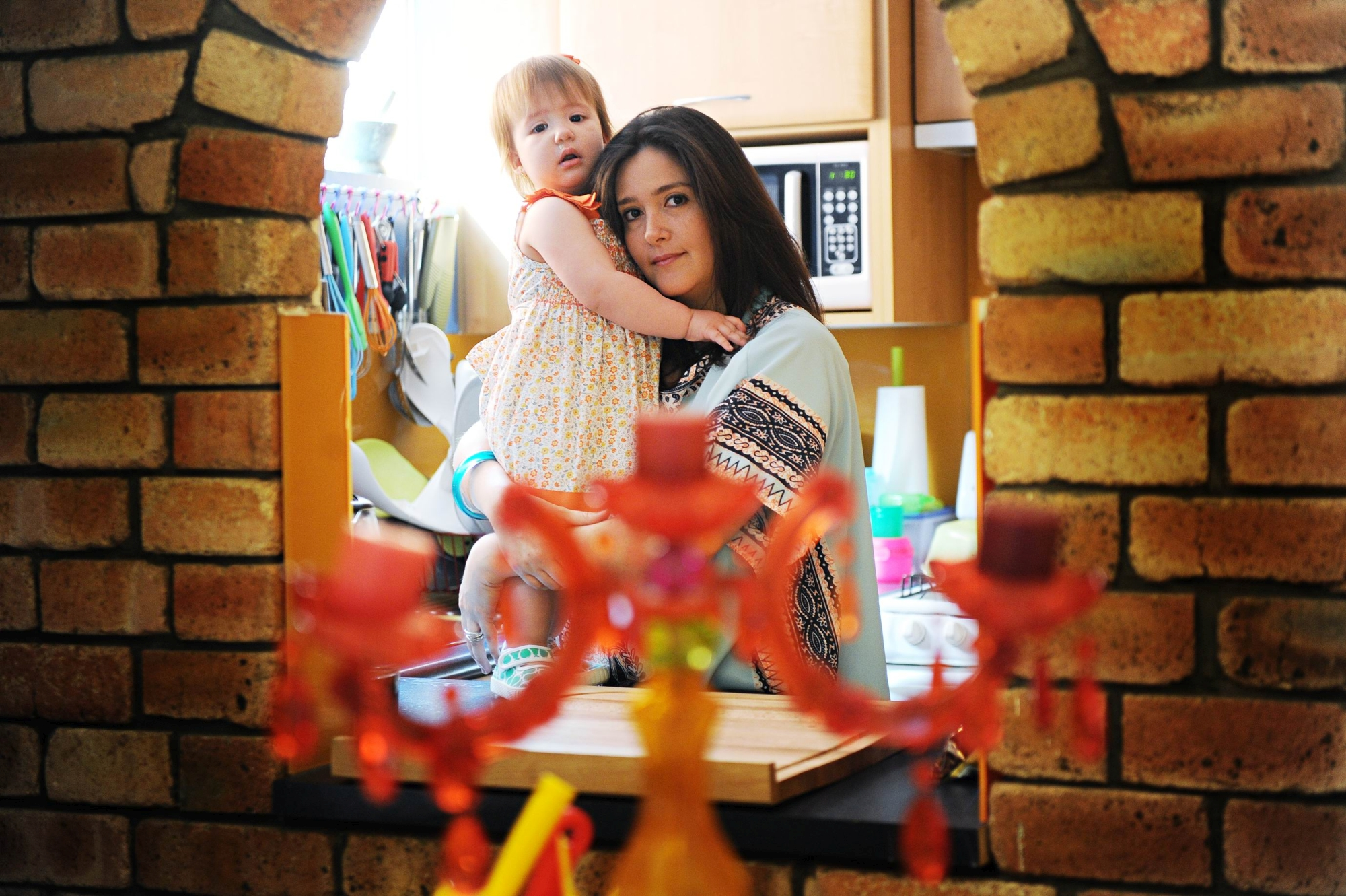 Scarborough resident Carolina Alvarez with her 15-month-old daughter Isabella. Picture: Marcus Whisson d410692b