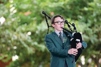 Year 9 student Emmanuel Terzoudis-Lumsden with his bagpipes. Picture: Martin Kennealey www.communitypix.com.au d405522
