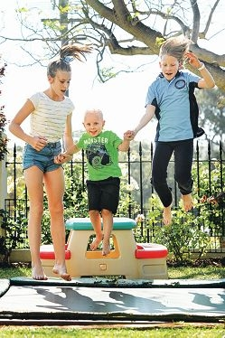 Archie Caldow (4) and his sisters, from left, Olivia (13) and Remi (9) enjoy themselves on the family's trampoline.