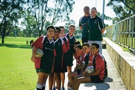 Some of the Wanneroo Districts Rugby Union Football Club Under 13's players with their two coaches, they recently received a grant to help with overseas trips for international games