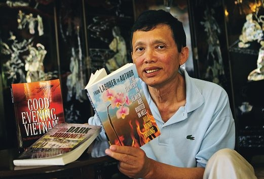 Hoa Minh Truong with three of his books. Picture: David Baylis www.communitypix.com.au d410430