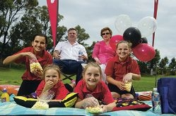 Ben Bryant and Lyn Carmichael with (in front) Laura de Silva-Beiter, Skye Bryant, Abbey Bryant and Grace Bryant at the Hillarys Primary School's 40th anniversary celebration.