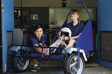 Andrew Cale and Tom Holland created a go-kart out of scooters donated by WA Police. www.communitypix.com.au d409776