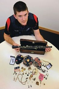 Bayswater Police Station's Constable Scott Starkie with distinctive jewellery and an old oboe. |Picture: Marcus Whisson d410916