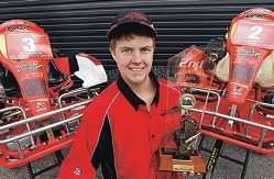 Toby Collins has his trophy on display at work.|Picture: Elle Borgward www.communitypix.com.au d410907