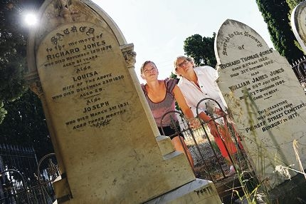 National Trust of Australia education officers, from left, Kim Hawkes and Diana Frylinck among some of the oldest tombstones at East Perth Cemeteries. Picture: Marcus Whisson d410667