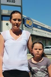 Hayley Worrall, pictured with daughter Tyler, was upset after her father, who has rectal cancer, was refused access to a toilet at BCF Mandurah.