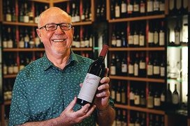 Mike Grant with the bottle of Penfolds Grange 1993 he is giving away at Hullabaloo. Picture: Andrew Ritchie www.communitypix.com.au d410288