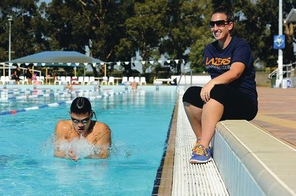Coach Stacey Scott with one of her charges, swimmer Tommy Sucipto. Picture: Marcus Whisson www.communitypix.com.au d410018